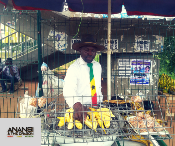man in tie selling roasted plantain near accra mall