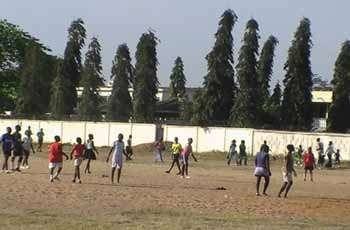 football players in Africa on a bare pitch